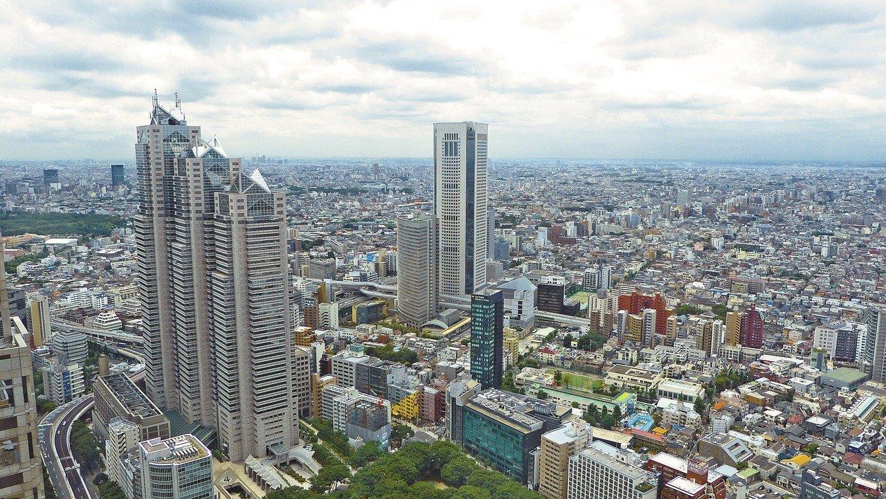 高層ビルの上から映った都市の背景